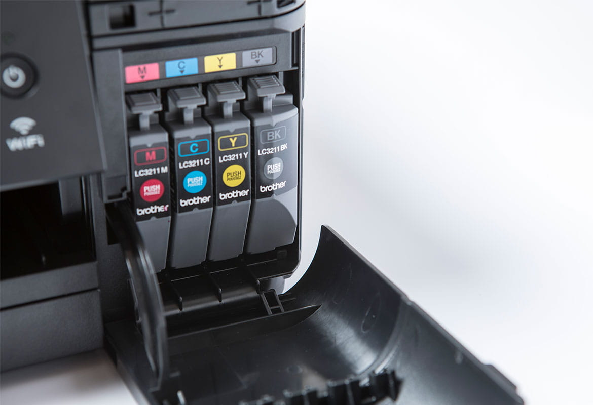 four brother ink cartridges inside a printer