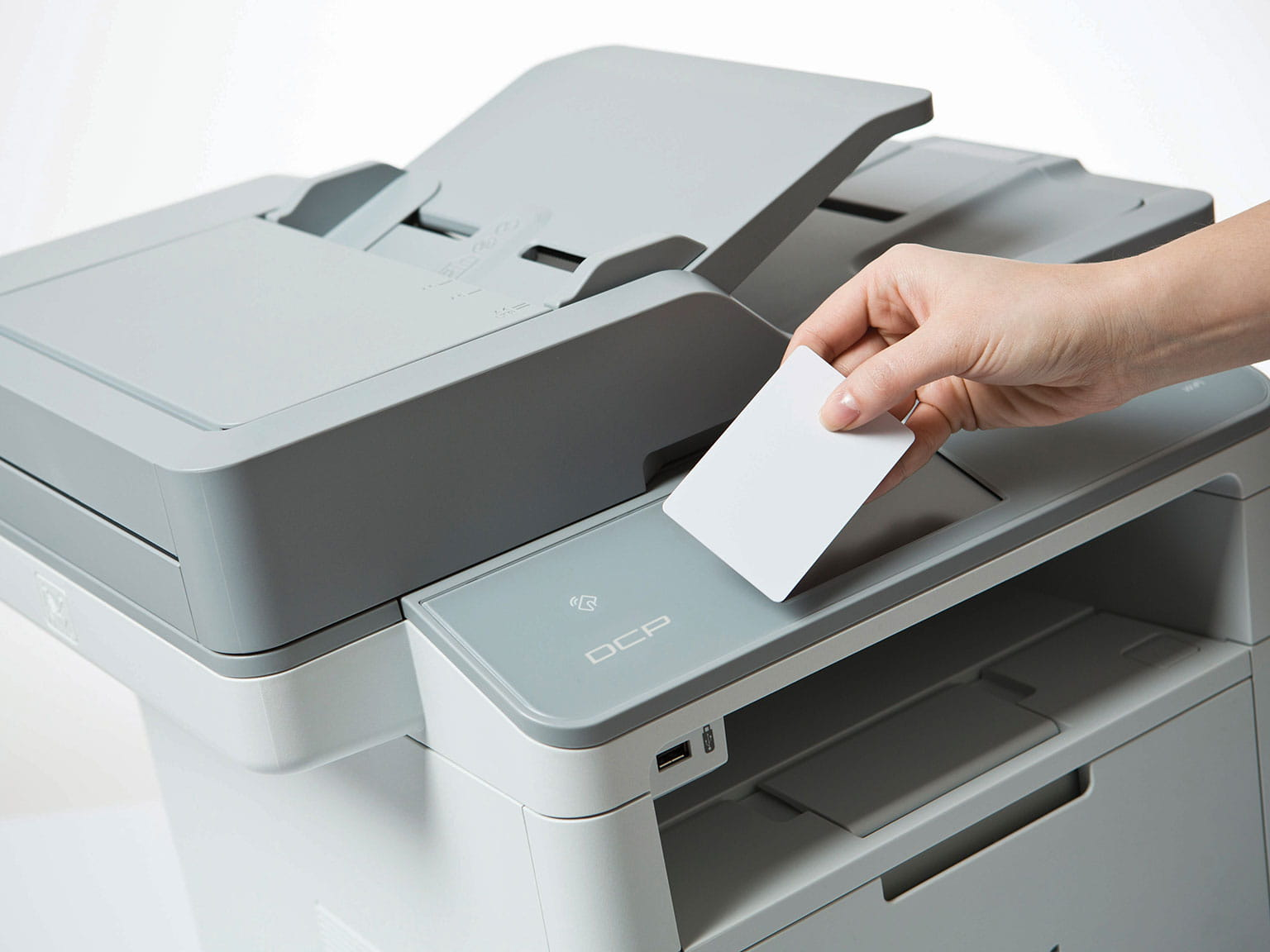 Person using a printer with an ID card