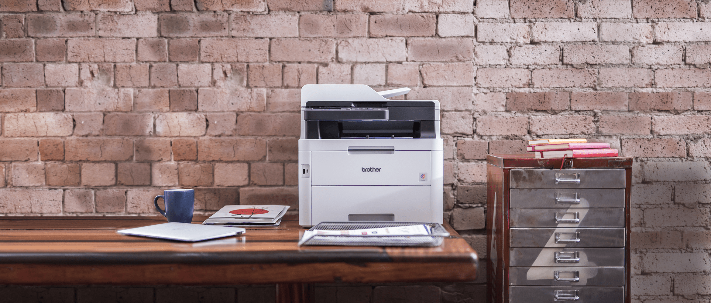 Brother DCP-L3550CDW colour laser printer on a desk