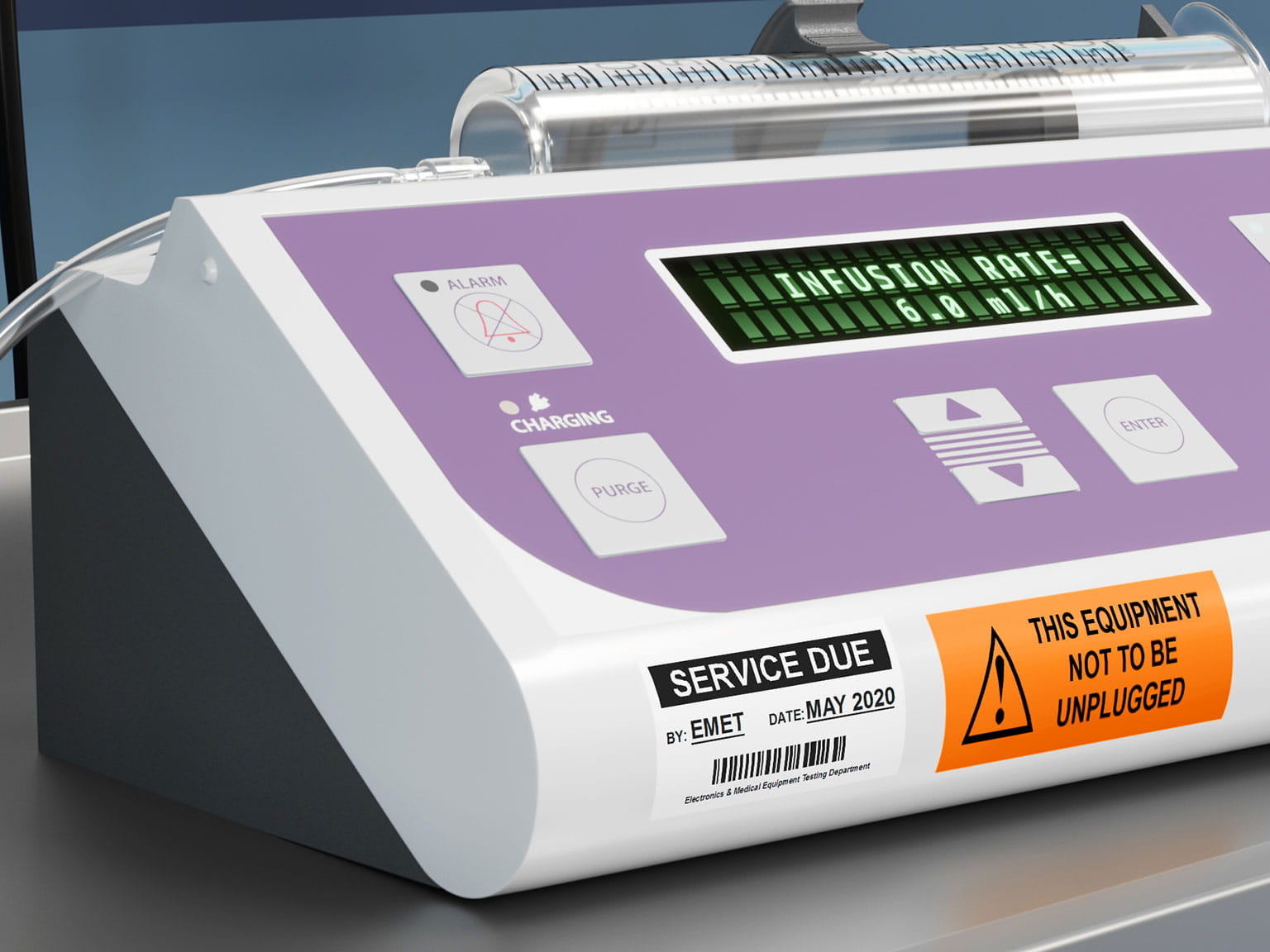 Service information on Brother P-touch TZe laminated label attached to syringe driver in a hospital