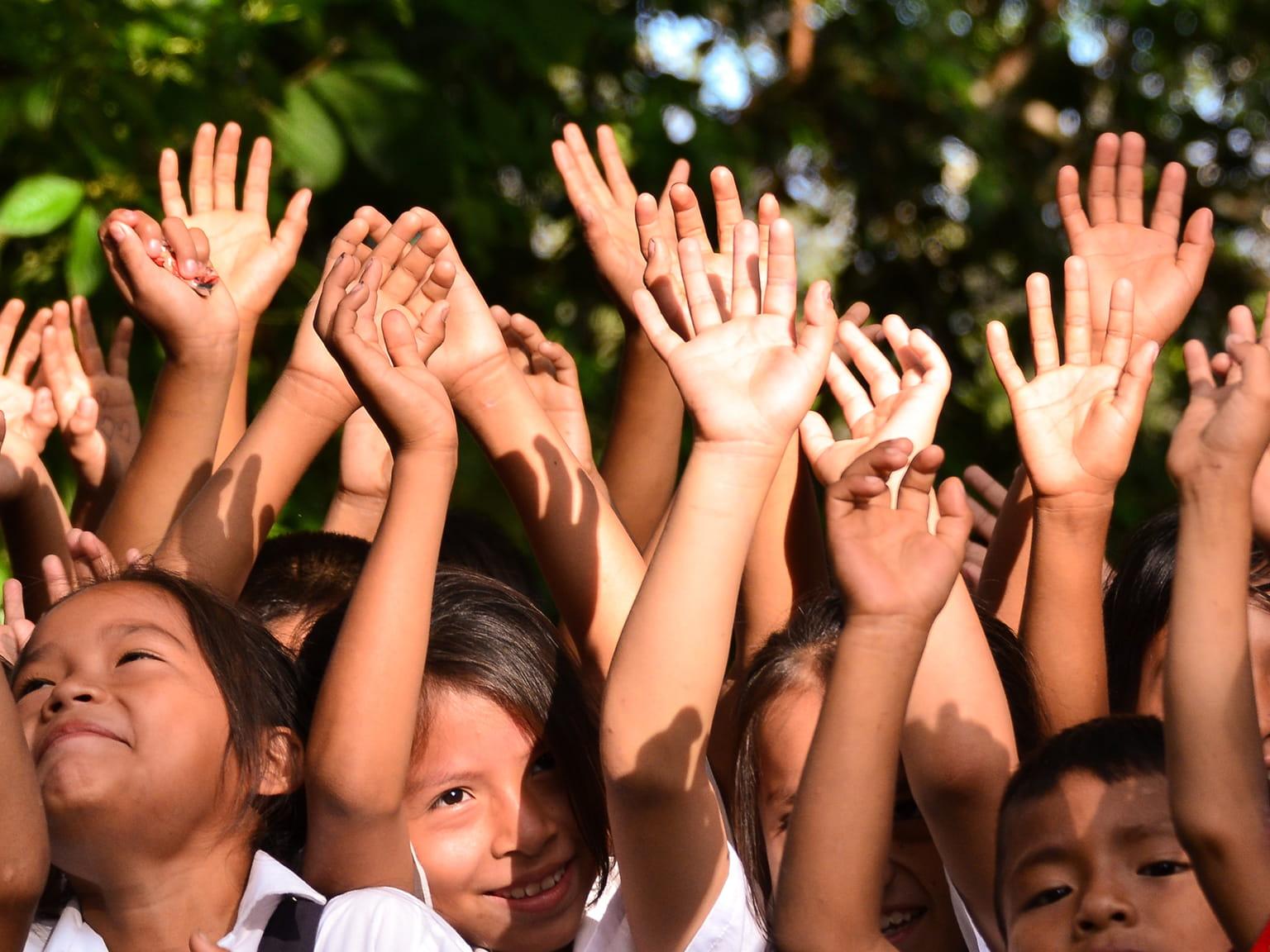 Kids waving hands