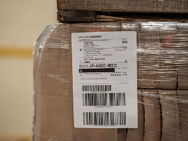 four inch industrial label  on packaged brown box