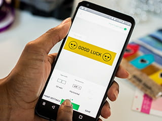 P-touch Design&Print app on smartphone being used to create a label