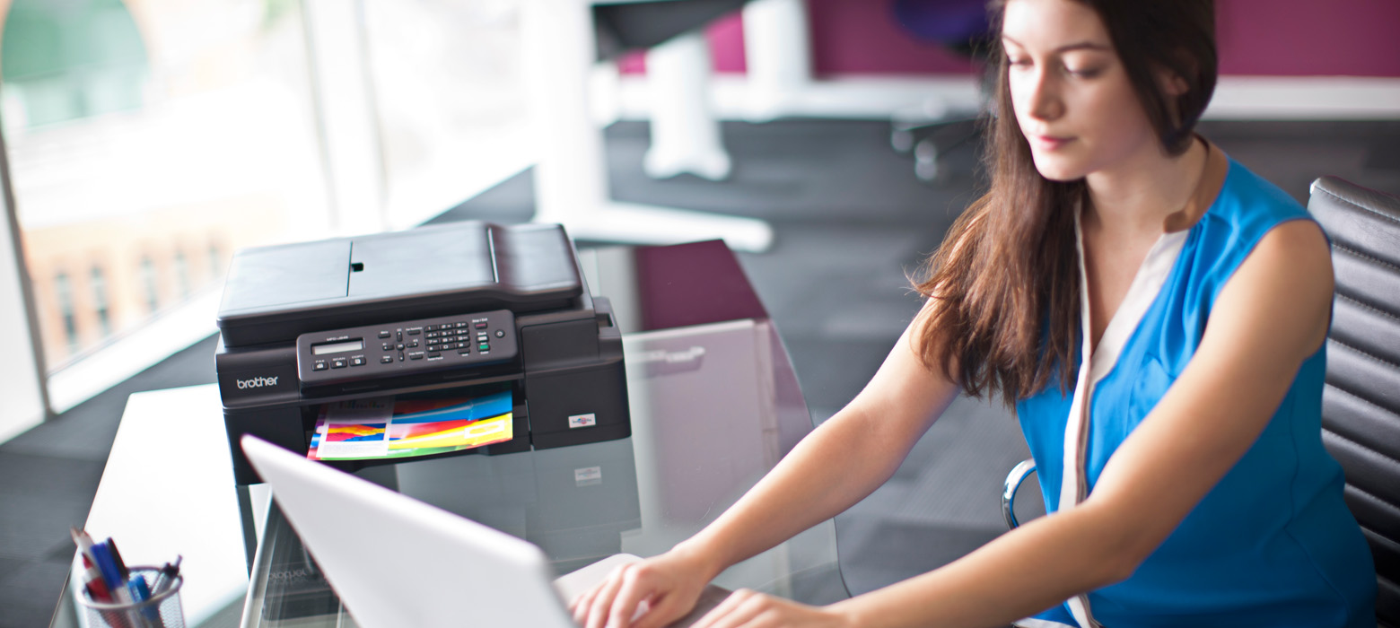 young-lady-on-her-computer-printing-from-from-her-brother-computer