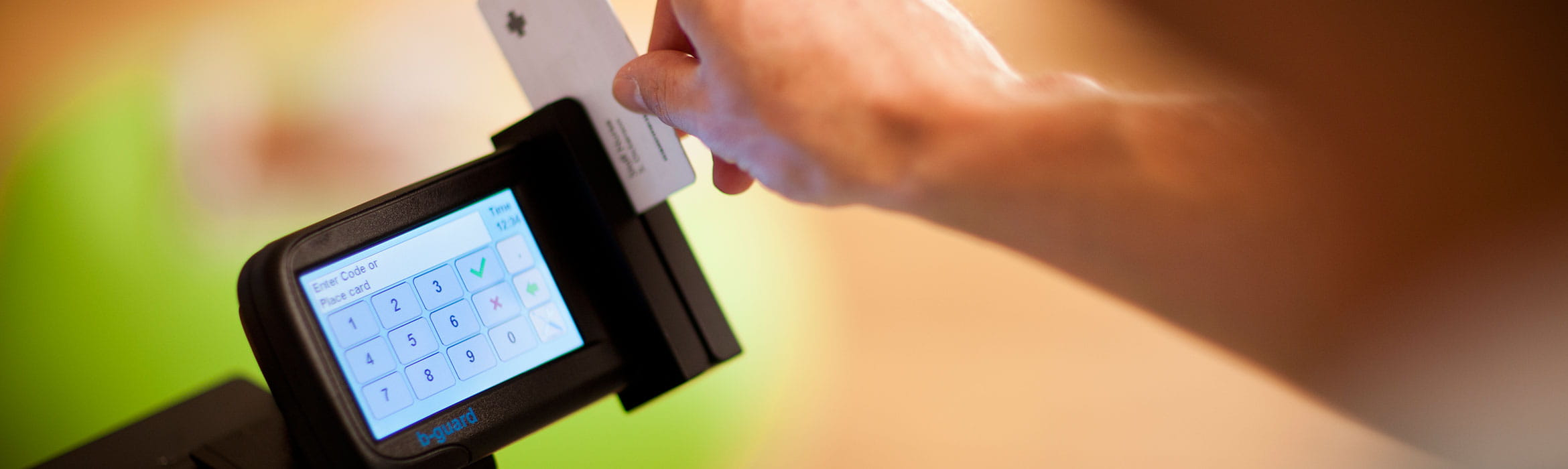 Person using an ID card reader on a Brother printer