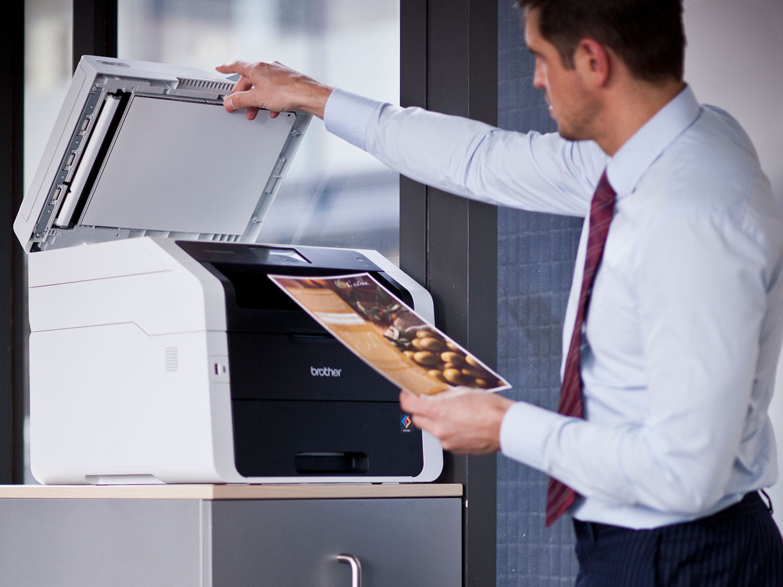Man using a Brother printer in the office