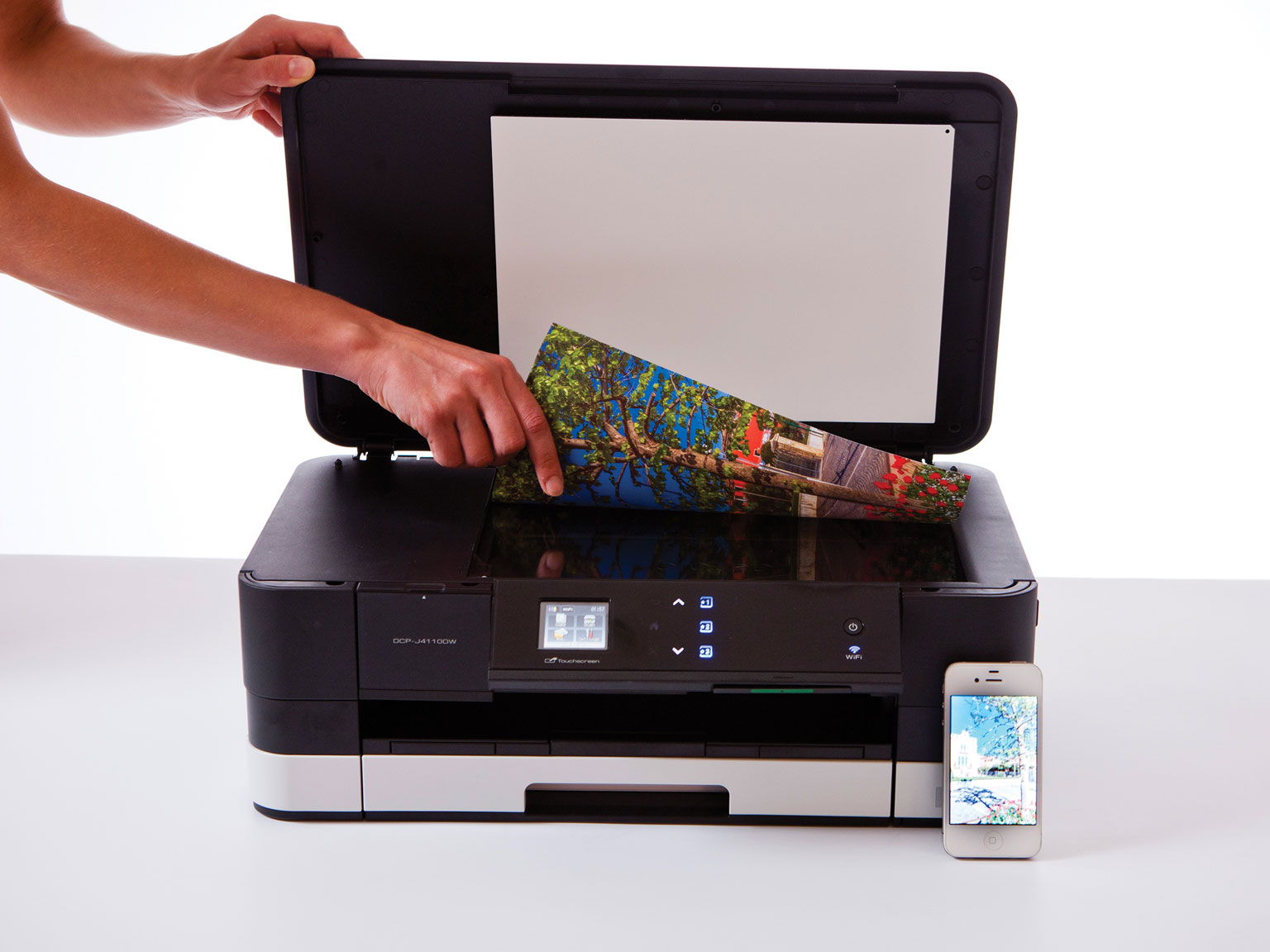 Person scanning a document in a Brother printer